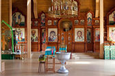 Interior rustic wooden Orthodox church — Stock Photo