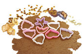 Cookie cutters on the rolled out dough — Stock Photo