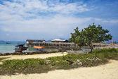 Village on the coast of tropical sea — Stock Photo