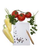 Leaf notebook in frame of vegetables — Stock Photo