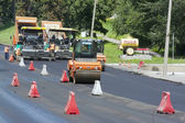 Workers laid asphalt on road — Stock Photo