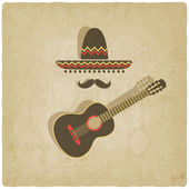 Mexican sombrero and guitar old background — Stock Vector