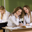 Schoolgirls discuss phone — Stock Photo