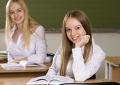 Young girls in school — Foto Stock