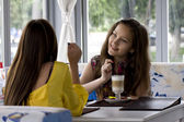 Girlfriends in cafe — Stock Photo
