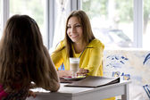 Conversation of girls behind a cup of coffee — Stock Photo