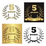 Set of golden laurel wreath with golden digit of jubilee years, golden ribbon on golden, black and white background. eps10 vector illustration — Stock Vector