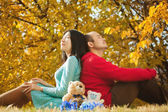 Young asian couple in love and having some autumn fun — Stock Photo