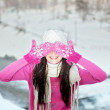 Smiling girl on snow winter background — Stock Photo #18439467