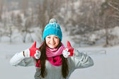 Smiling girl on snow winter background — Stock Photo
