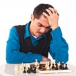 Man playing chess on white background - Stock Photo