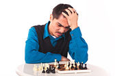Man playing chess on white background — Stock Photo