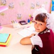 School girl doing homework — Stockfoto