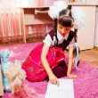 School girl doing homework — Foto Stock