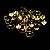Cod liver oil capsule pills — Stock Photo