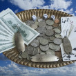 Still life - collage with money on a bronze tray, flying in the sky. — Stock Photo
