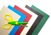 Coloured cardboard with scissors — Stock fotografie