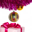 Stock Photo: Gift with tinsel and toys