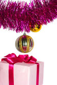 Gift with tinsel and toys — Stock Photo