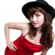 Girl in a red dress and in a black hat — Stock Photo