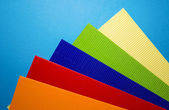 Coloured cardboard with scissors — Stock Photo