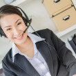 Stock Photo: Business women with headphone