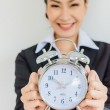 Young business women with clock — Stock Photo #33060375