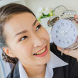 Young business women with clock — Stock Photo