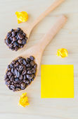 Note and coffee beans — Stock Photo