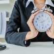 Young business women with clock — Foto de Stock