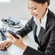 Young business women use moblie phone — Stock Photo