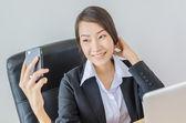 Business women take a photo — Stock Photo