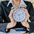 Stock Photo: Young business women with clock