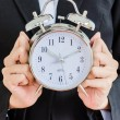 Stock Photo: Clock on bussiness hand