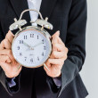 Clock on bussiness hand — Stock Photo