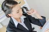 Business women thinking in office — Stock Photo