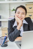 Business women happy with laptop in office — Stock Photo