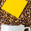 Note&coffee beans — Stock Photo