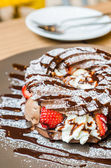 Chocolate chou with strawberry and icecream — Stock Photo