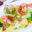 Stock Photo: Grilled king prawns pernod served with dill potatoes