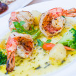 Grilled king prawns pernod served with dill potatoes — Stock Photo