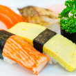 Sushi on white dish — Stock Photo
