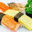 Sushi on white dish — Stock Photo
