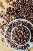 Coffee beans on cup — Stock Photo