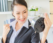 Young business woman with clock — Foto de Stock
