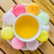 Colorful macaroon with white cup tea — Stock fotografie