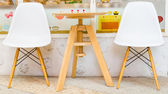 Wooden chairs and a table — Stock Photo