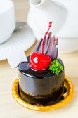 Chocolate cake with cherry — Stock Photo