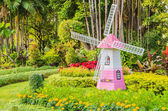 Windmill in the garden — Stock Photo