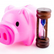 Stock Photo: Piggy bank sand clock isolated white background